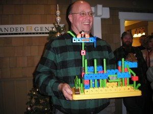 Steve Baughn showing off his teams masterpiece from the home building contest!